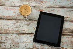 Digital tablet and cup of coffee Stock Image