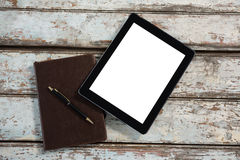 Digital tablet and diary with pen Stock Image