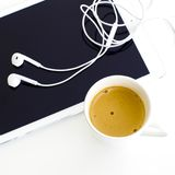 Digital tablet and earphone and white coffee cup on white backgr Stock Photo