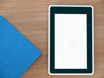 Digital tablet finger touch blank screen. Digital tablet finger touch blank screen , on work table Royalty Free Stock Photo
