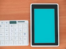 Digital tablet finger touch blank screen. Digital tablet finger touch blank screen , on work table Royalty Free Stock Photography