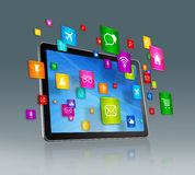 Digital Tablet and flying apps icons Royalty Free Stock Images