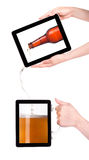 Digital tablet with fresh beer pouring down Royalty Free Stock Photo