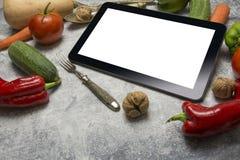 Digital tablet with fresh vegetables Stock Image
