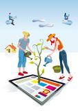 Digital Tablet Gardeners. A man and a woman dressed as gardeners work creatively. They care and bring life a digital tablets. Other people download this content Stock Photography