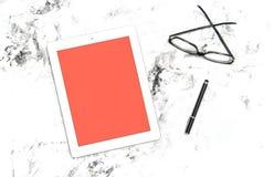 Digital tablet glasses Minimal flat lay Living coral pantone. Digital tablet pc, pen and glasses. Minimal flat lay. Living coral pantone screen background stock image