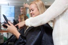 Digital Tablet at Hair Salon Royalty Free Stock Photos