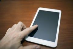 Digital Tablet. Hand On New Digital Tablet Royalty Free Stock Image