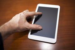 Digital Tablet. Hand On New Digital Tablet Stock Photo