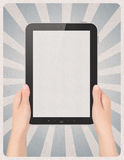 Digital tablet in hands on retro background Stock Photos