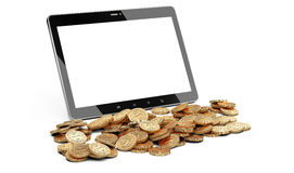 Digital tablet and heap of coins. Stock Photo