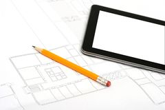 Digital tablet on house plan Stock Image