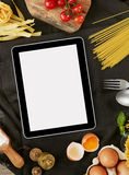 Digital tablet and ingredients Royalty Free Stock Images