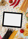 Digital tablet and ingredients Stock Image