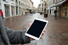 Digital tablet with isolated screen in male hands. Royalty Free Stock Photo