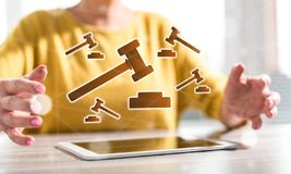 Concept of judgment. Digital tablet with judgment concept between hands of a woman in background royalty free stock image