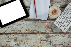 Digital tablet and keyboard with a cup of coffee Stock Photos