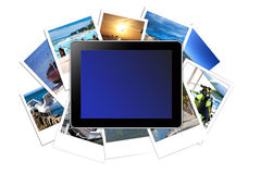 Digital Tablet lies on a stack of instant pictures Stock Photography