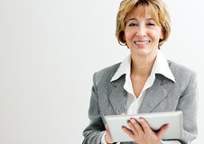 Digital tablet mature businesswoman Stock Photo
