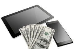 Digital Tablet and mobile phone with US Dollars Royalty Free Stock Photography