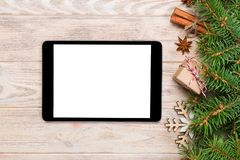Digital tablet mock up with rustic Christmas wood background decorations for app presentation. top view with copy space.  royalty free stock photos
