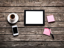 Digital tablet with note paper and cup of coffee Stock Photos