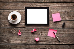 Digital tablet with note paper and cup of coffee Stock Images