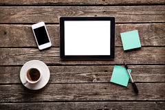 Digital tablet with note paper and cup of coffee Stock Image