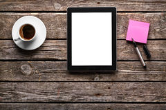 Digital tablet with note paper and cup of coffee Stock Photography