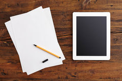 Digital Tablet and Note Paper Royalty Free Stock Photo