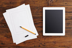 Digital Tablet and Note Paper Royalty Free Stock Photography