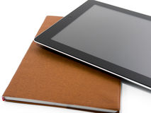 Digital tablet and notebook. On white royalty free stock photos