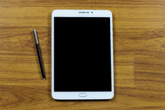 Digital tablet on office table Stock Image
