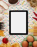 Digital tablet, pasta and ingredients Royalty Free Stock Photo
