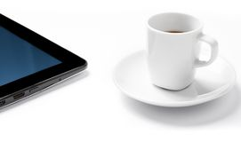 Digital tablet pc near cup of coffee, concept of new technology Stock Photos