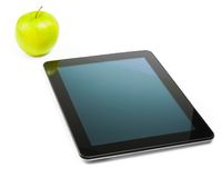 Digital tablet pc near green apple on white background Stock Photography