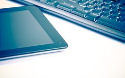 Digital tablet pc near keyboard, concept of new technology Stock Photos
