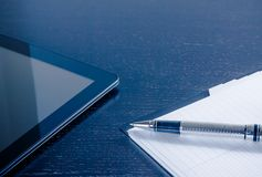 Digital tablet pc near notes in the office, concept of new technology Royalty Free Stock Photo