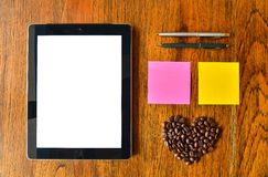 Digital tablet pc, pen, colorful stick note and coffee bean Royalty Free Stock Images