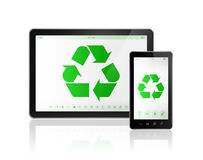 Digital tablet PC with a recycle symbol on screen. environmental Stock Photos