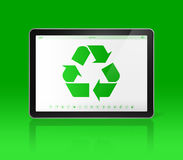 Digital tablet PC with a recycling symbol on screen. ecological. 3D Digital tablet PC with a recycling symbol on screen. ecological concept Royalty Free Stock Image