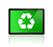 Digital tablet PC with a recycling symbol on screen. environment Stock Photos