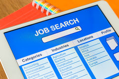 Digital tablet pc showing user interface of online job search Stock Photo