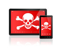 Digital tablet PC and smartphone with a pirate symbol on screen. Royalty Free Stock Photo