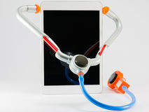 Digital tablet pc with toy stethoscope Stock Image