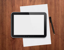 Digital tablet with pen on a desktop. Modern blank digital tablet with papers and pen on a wooden desk. Top view. High quality detailed graphic collage Royalty Free Stock Photography
