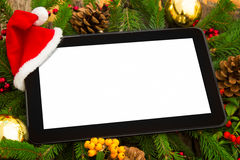 Digital tablet with Santa hat Royalty Free Stock Photography