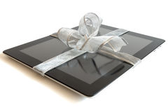 Digital tablet with silver ribbon Stock Images