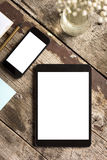 Digital tablet and smart phone on wooden table Royalty Free Stock Photography
