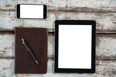 Digital tablet, smartphone and diary with pen Royalty Free Stock Photo